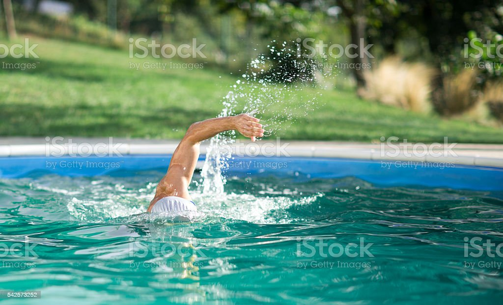 swimmer recreating on outdoor stock photo