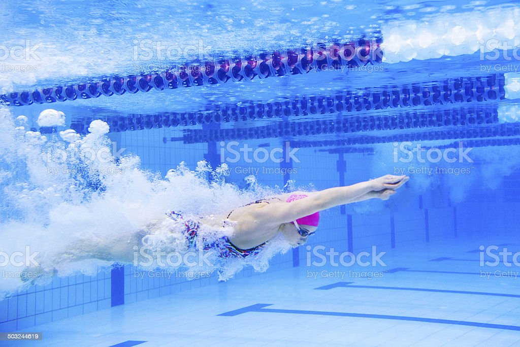 Swimmer speeding through the pool stock photo
