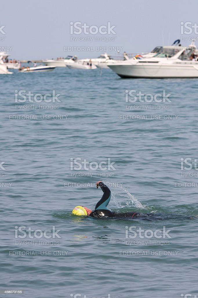 Swimmer Swims Freestyle In Lake Michigan Amid Party Boats royalty-free stock photo