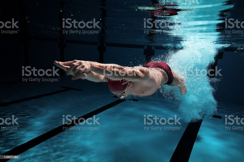 Swimmer under water after diving in royalty-free stock photo