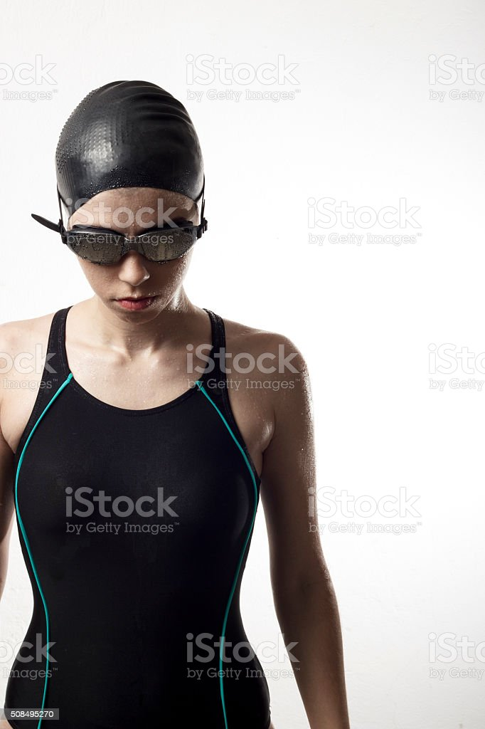 Swimmer woman focused looking down. stock photo
