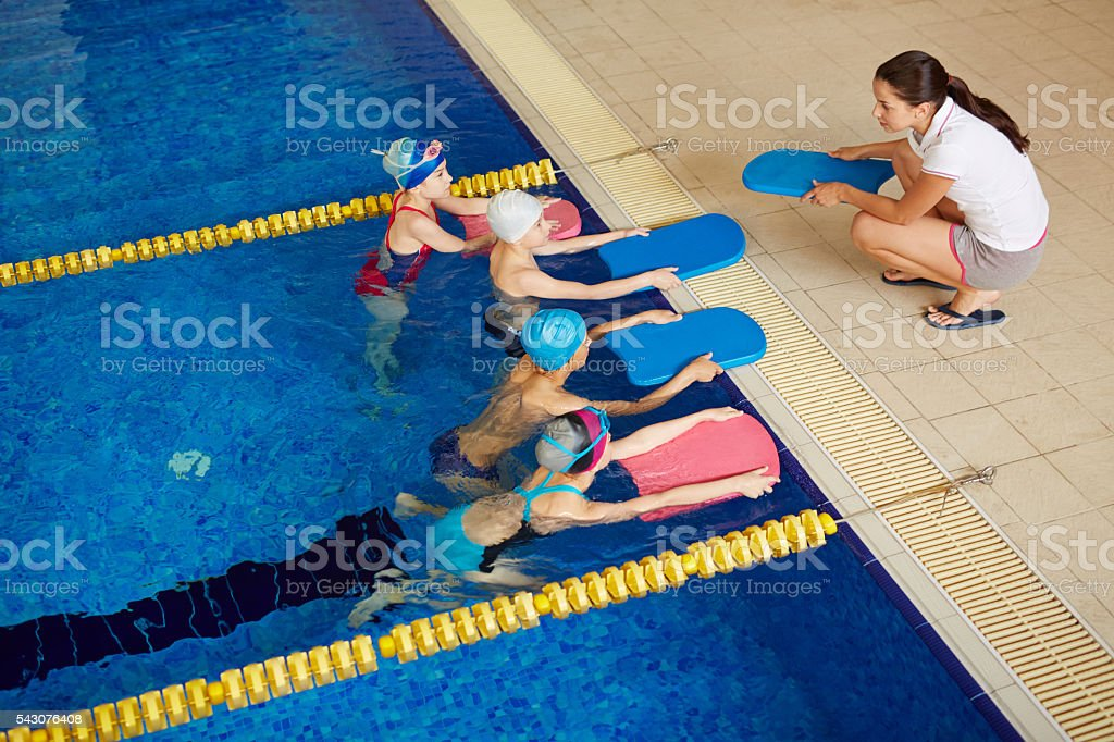 Swimmers with coach stock photo