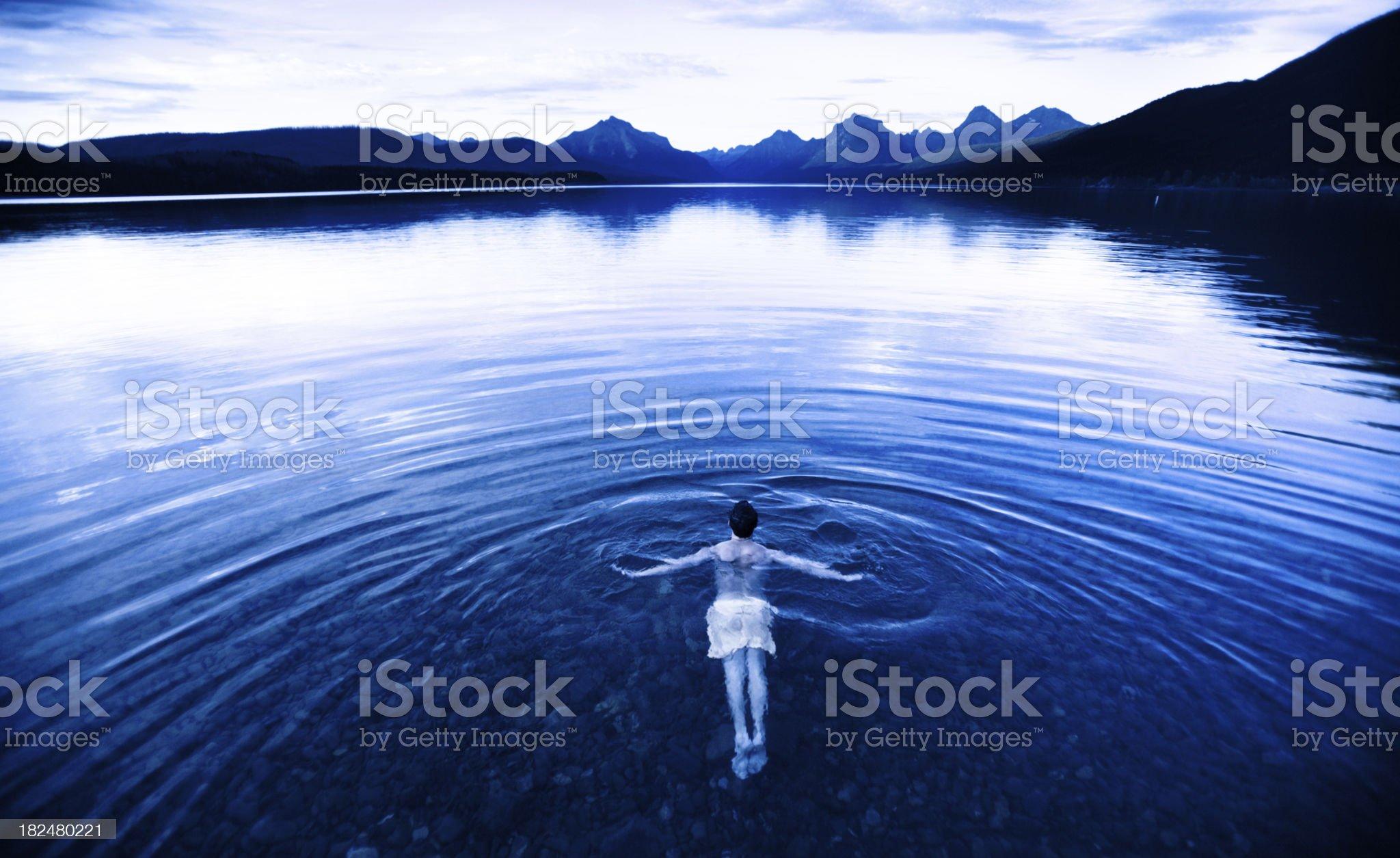 Swimming alone in a pristine mountain lake, Montana royalty-free stock photo