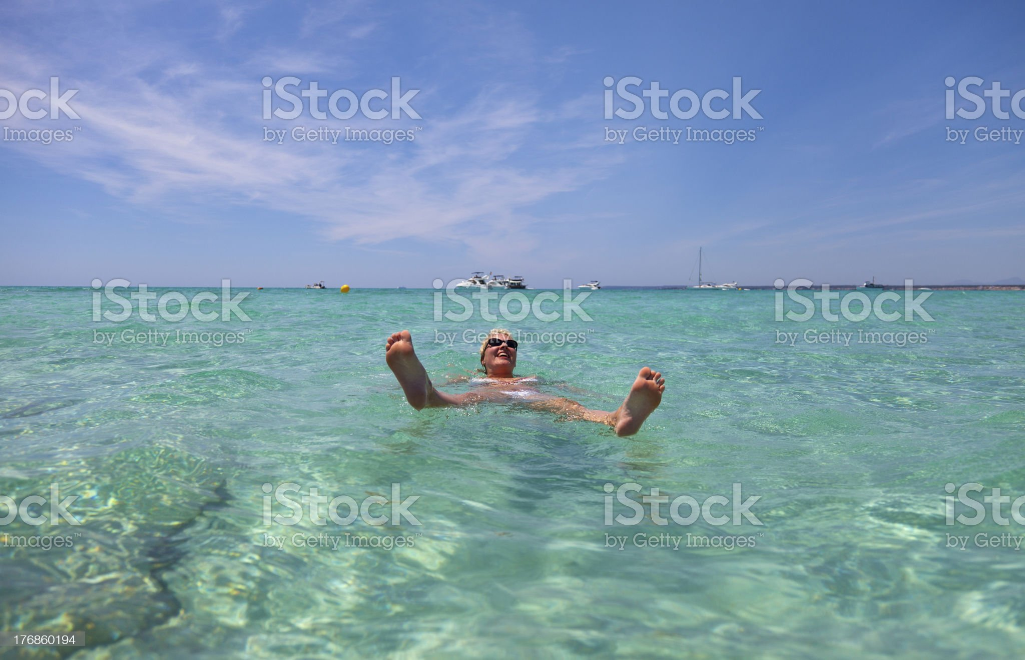 Swimming And Sunbathing At The Beautiful Beach Of ES TRENC. royalty-free stock photo