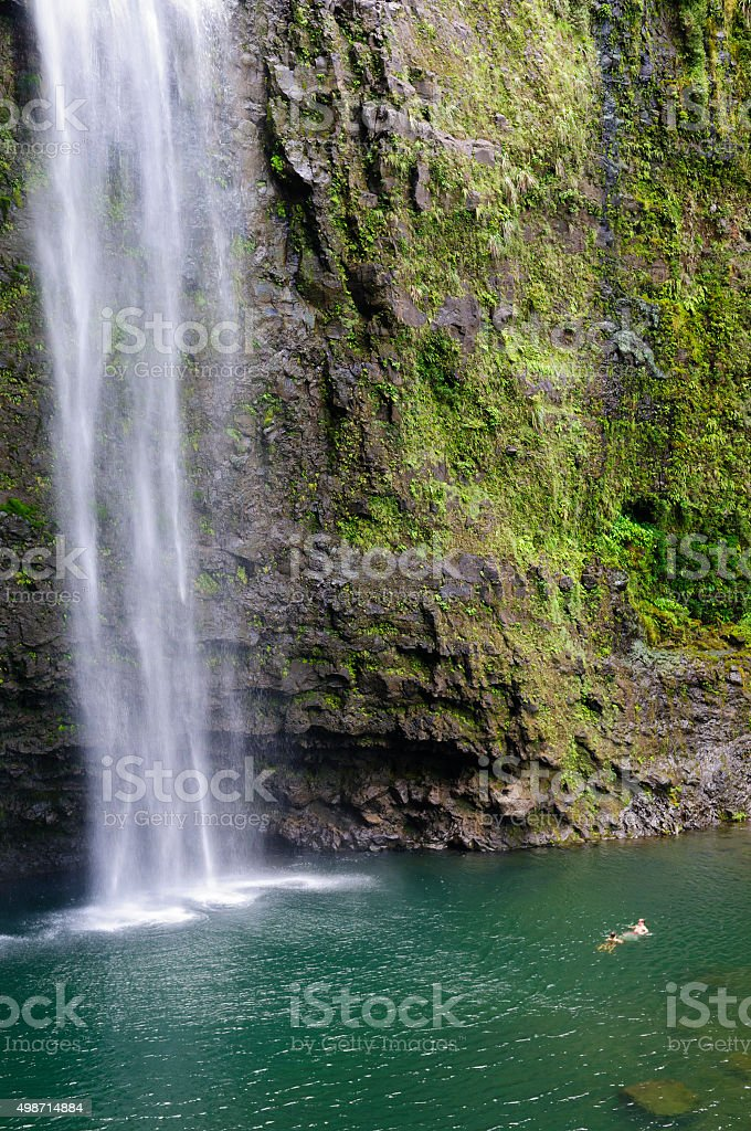 Swimming at Hanakapi'ai Falls on Kauai, Hawaii stock photo