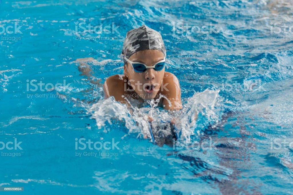 Swimming boy breaststroke style stock photo