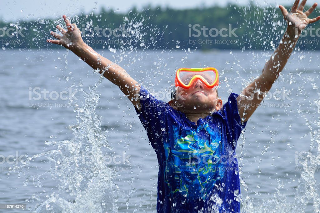Swimming Boy Has Fun In Summer Sun stock photo