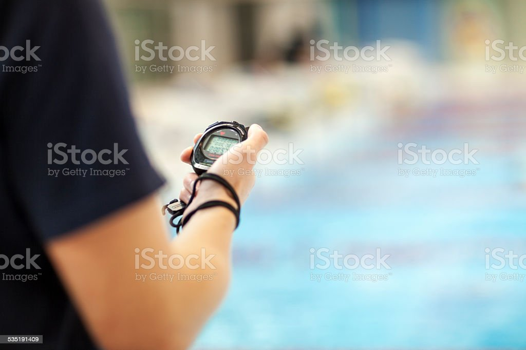 Swimming Coach Holding Stopwatch stock photo
