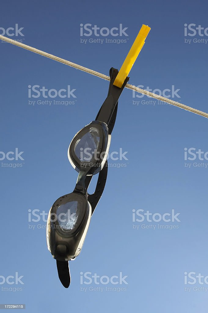 Swimming goggles drying on rope stock photo