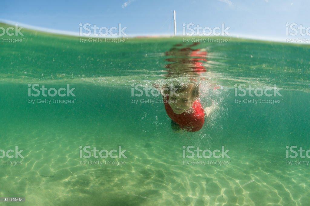 Swimming in beautiful water stock photo