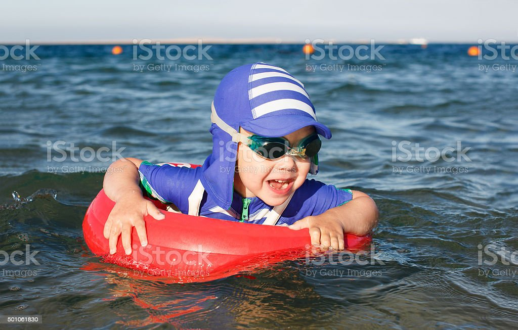 swimming in sea with inflatable ring stock photo