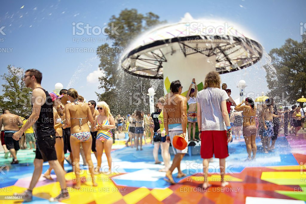 Swimming in the fountain at Bonnaroo Music Festival stock photo