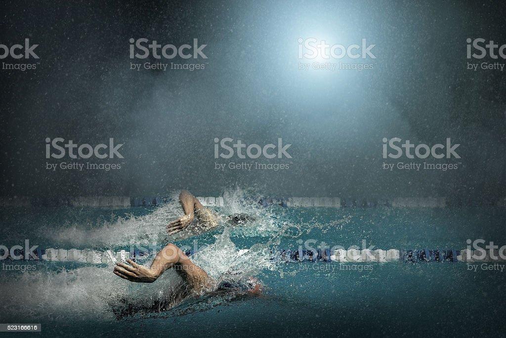 Swimming in waterpool stock photo