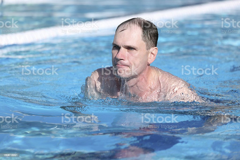 Swimming man royalty-free stock photo