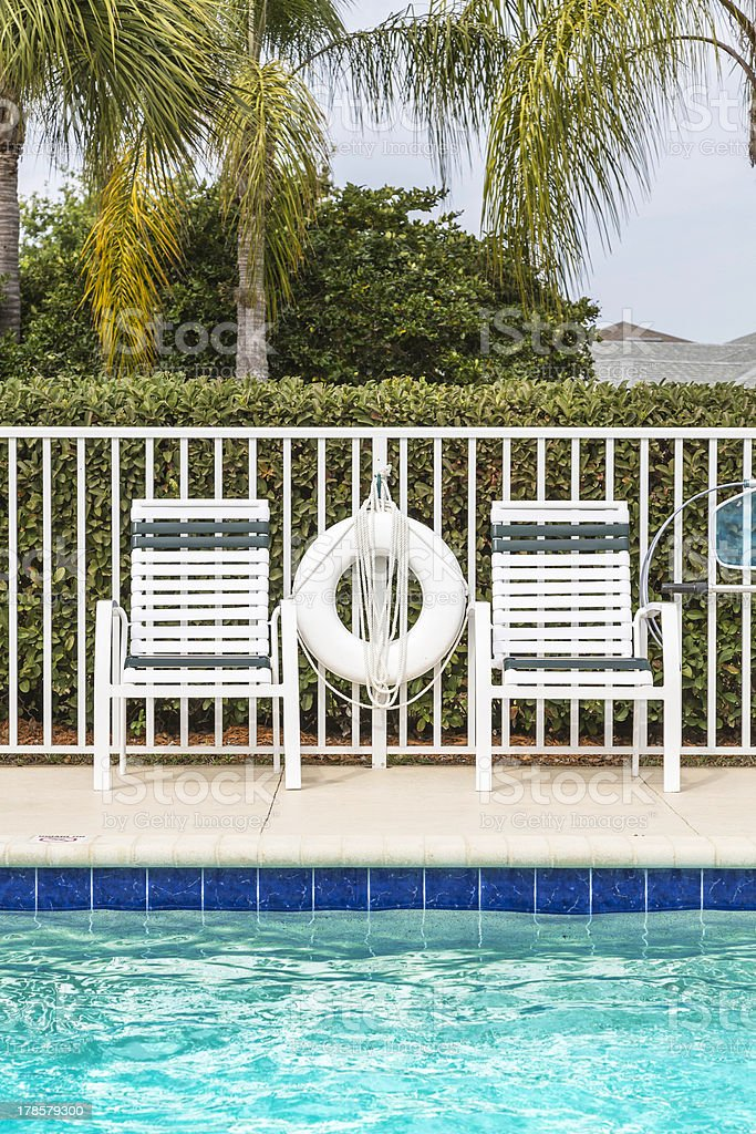 Swimming pool against palms royalty-free stock photo