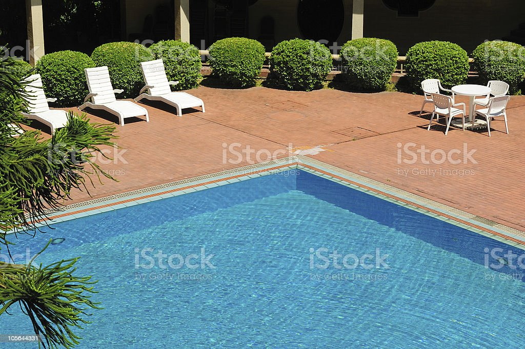 swimming pool and chaise longues royalty-free stock photo