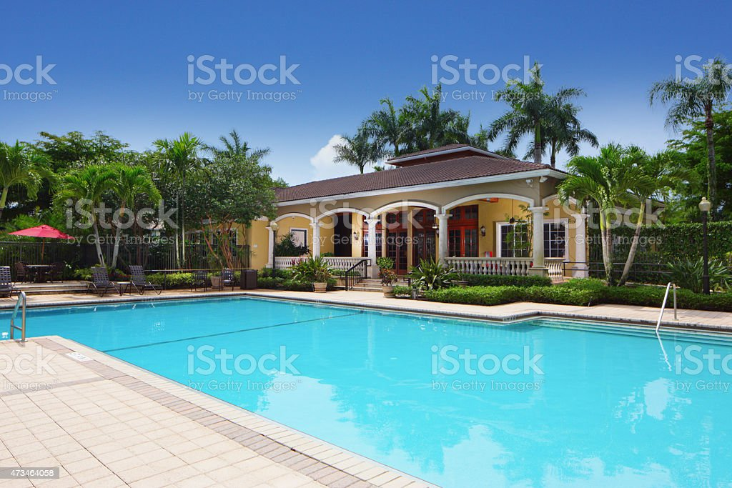 Swimming pool and club house stock photo