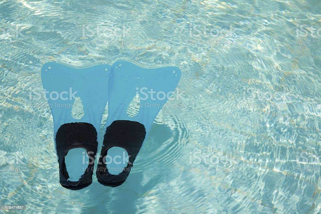 Swimming pool and fins royalty-free stock photo