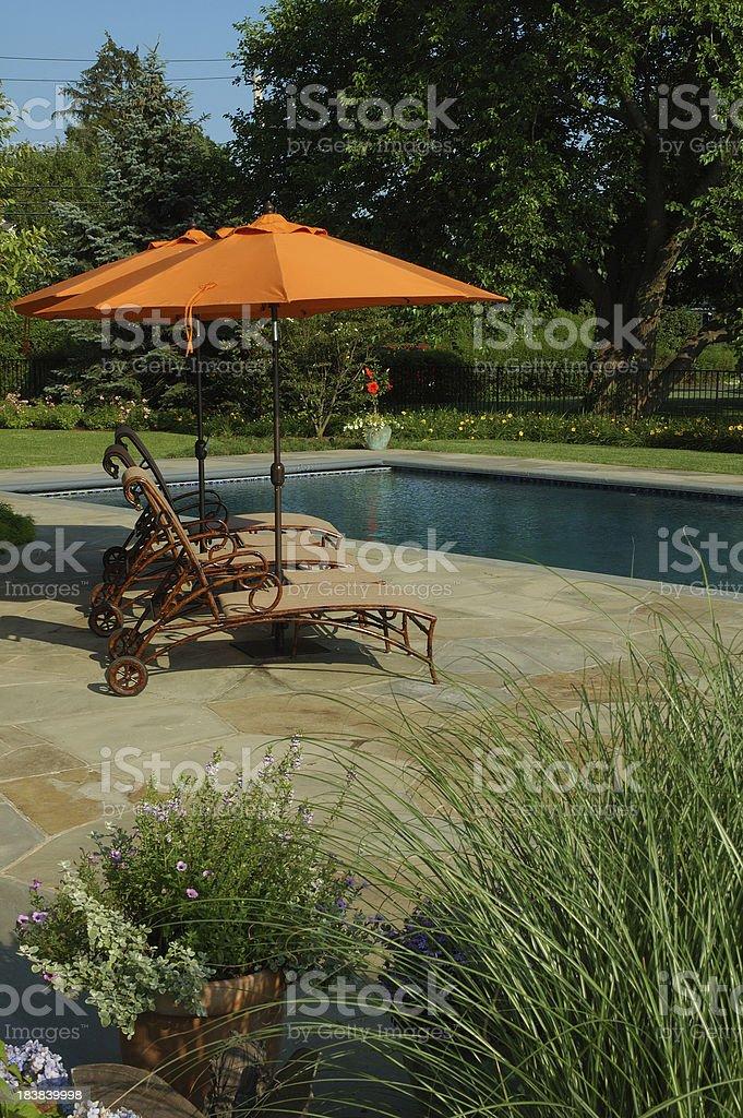 Swimming Pool and Garden Umbrella stock photo