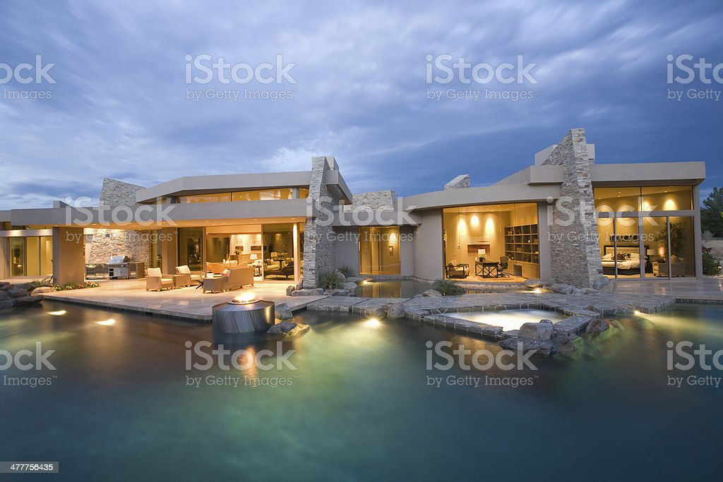 Swimming Pool And Illuminated Modern House stock photo