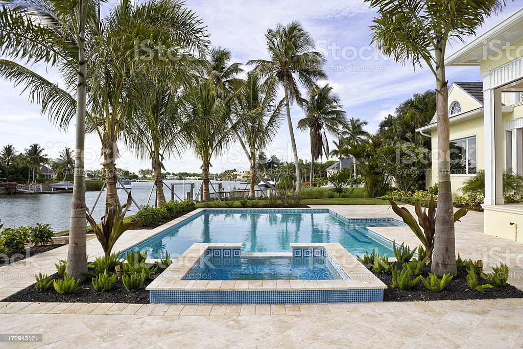 Swimming Pool and Spa Overlooking Waterway stock photo