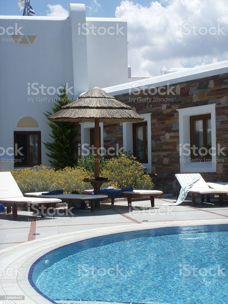 Swimming pool and tan beds royalty-free stock photo