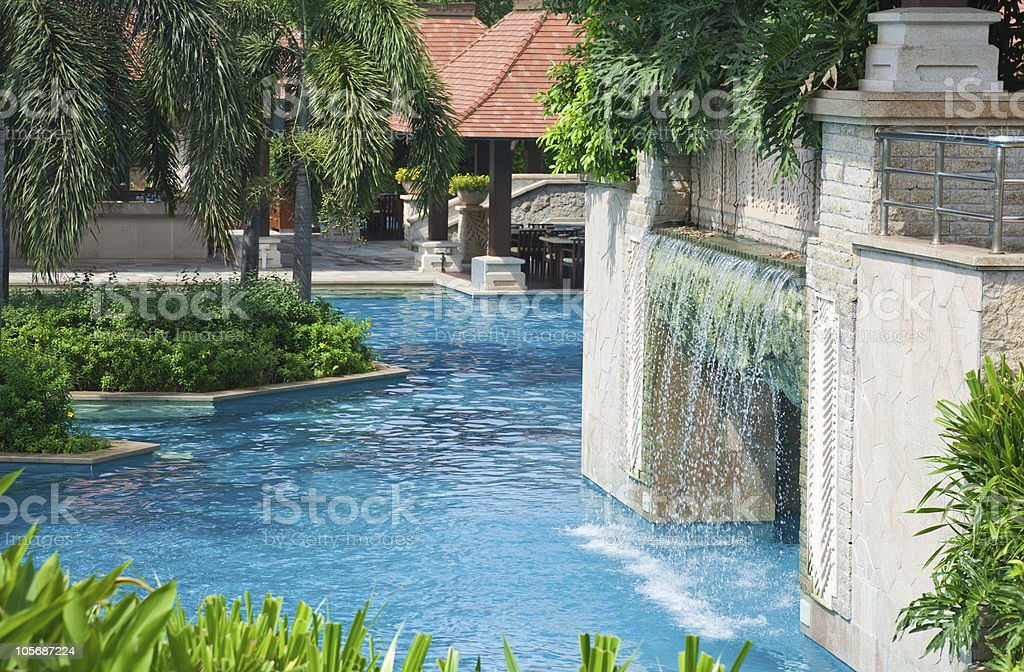 swimming pool and waterfall royalty-free stock photo