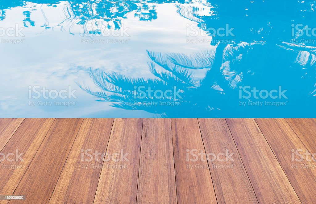 Swimming pool and wooden deck ideal for background stock photo
