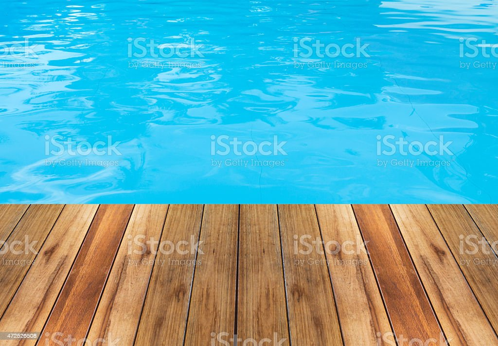 Swimming pool and wooden deck ideal for backgrounds stock photo