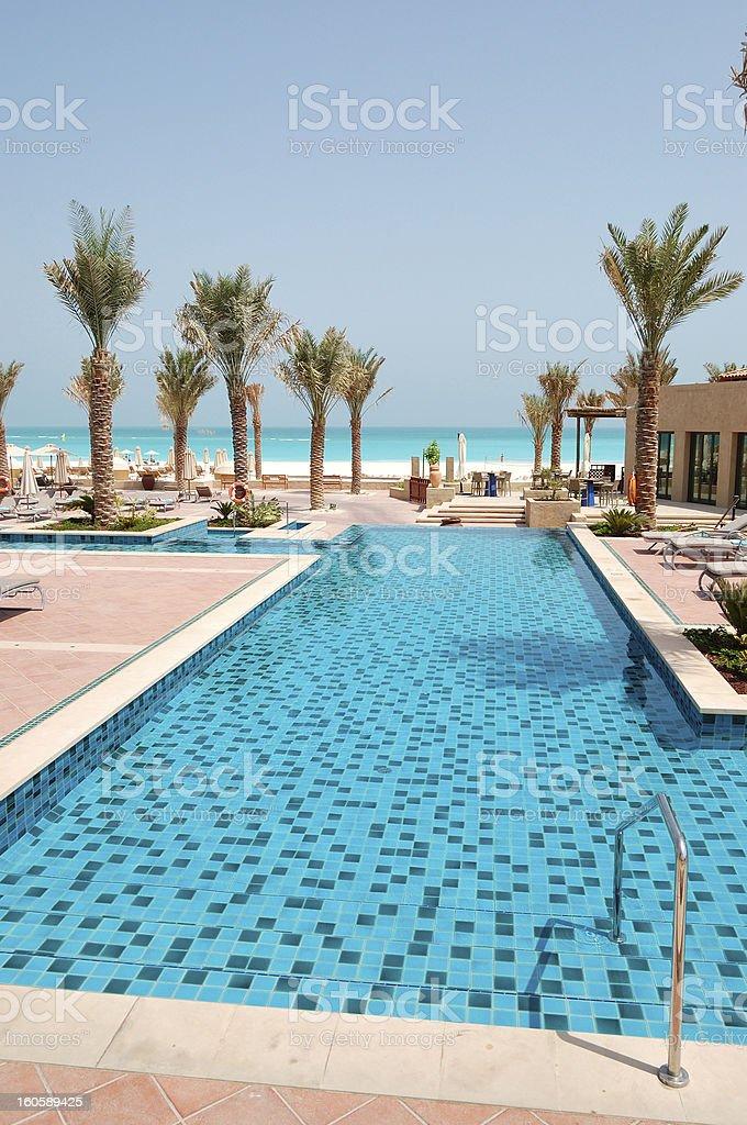 Swimming pool at beach of luxury hotel, Saadiyat island stock photo