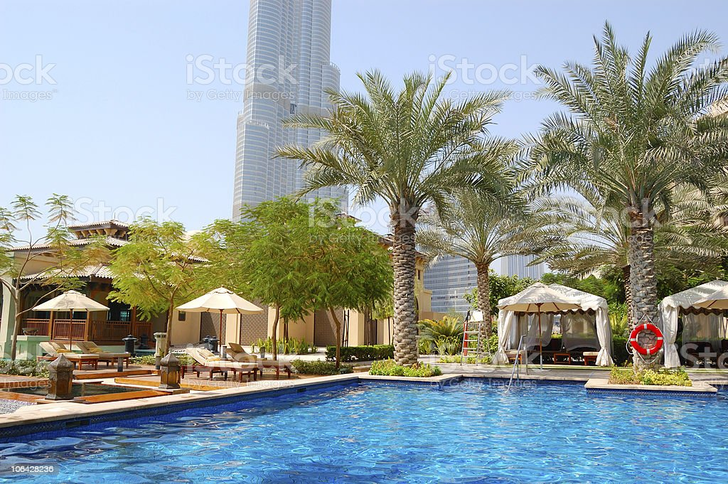 Swimming pool at luxury hotel in Dubai downtown, UAE royalty-free stock photo