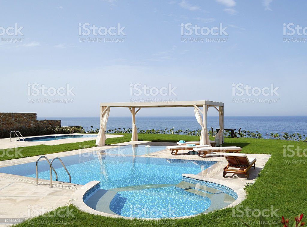Swimming pool at luxury villa, Crete, Greece royalty-free stock photo