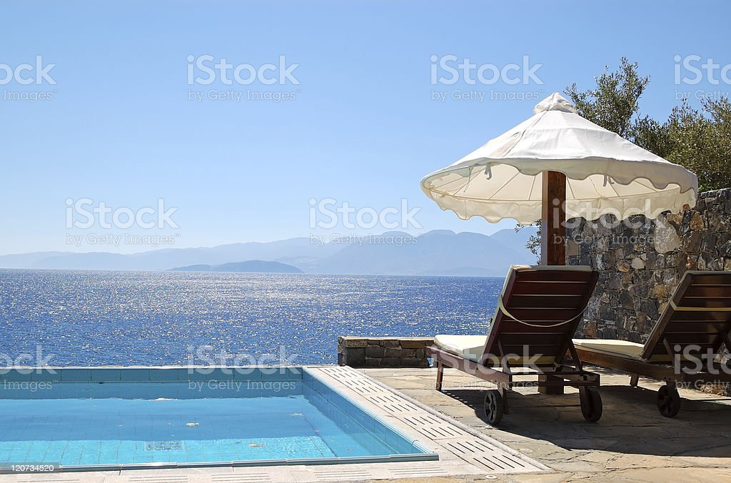 Swimming pool at luxury villa, Crete, Greece royalty-free stock photo