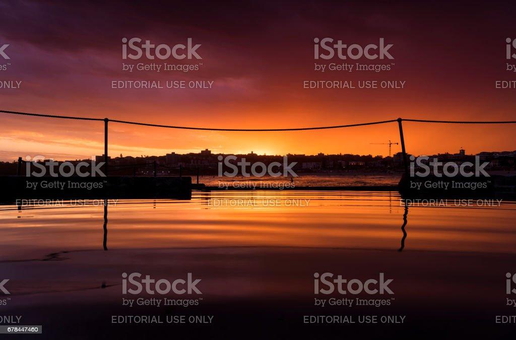 Swimming pool at sunset stock photo