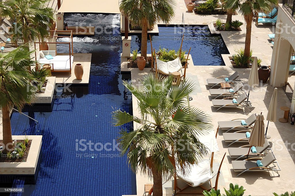 Swimming pool at the luxury hotel stock photo