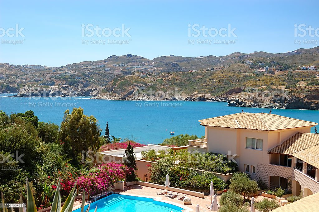 Swimming pool at the modern luxury villa, Crete, Greece royalty-free stock photo