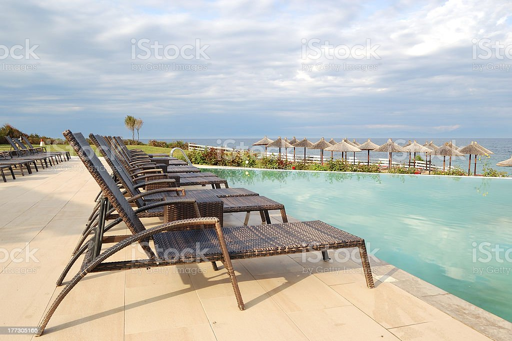 Swimming pool by a beach royalty-free stock photo