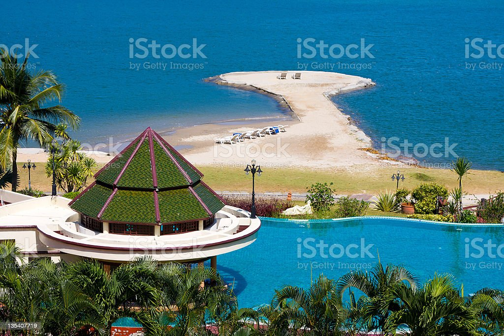 Swimming pool by the sea in Thailand stock photo