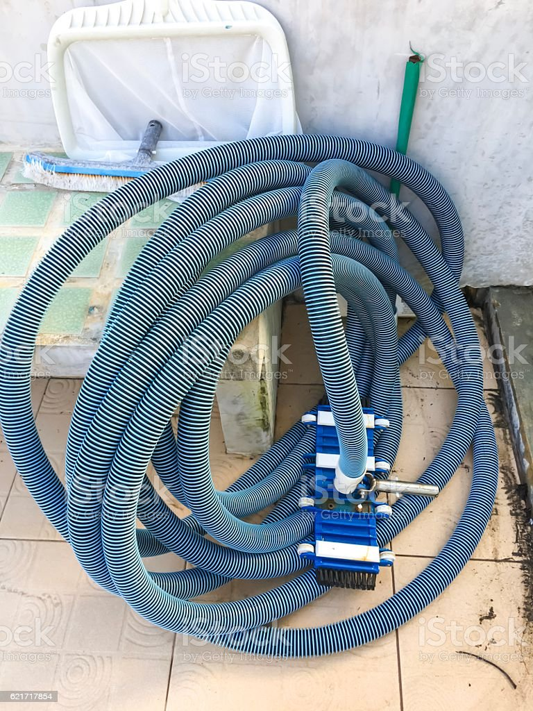 Swimming pool cleaning equipment/tools, Swimming pool vacuum hose, white skimmer royalty-free stock photo