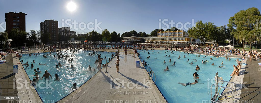 Swimming pool crowd panorama from the lifeguard perspective stock photo