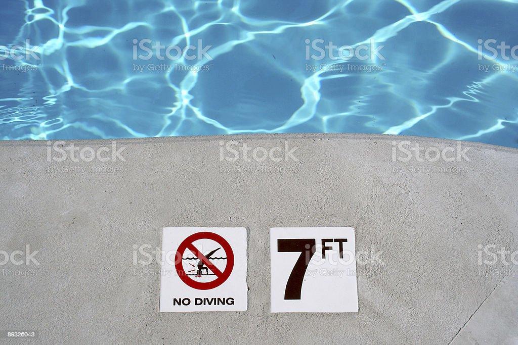 Swimming pool depth marker royalty-free stock photo