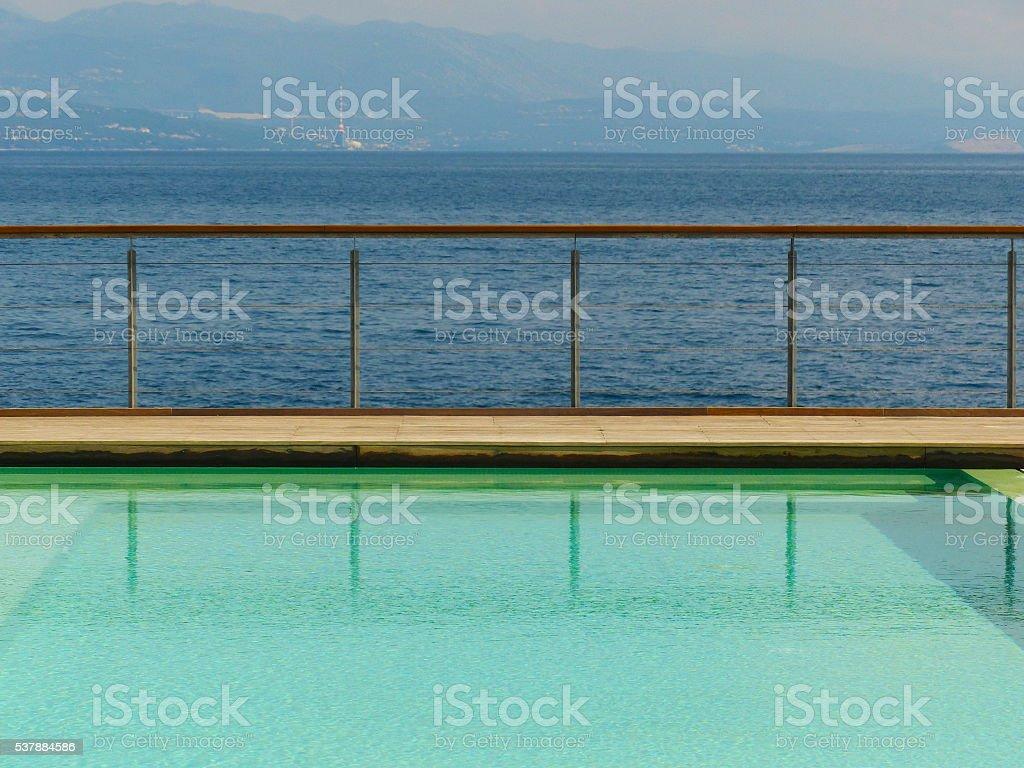 Swimming pool guard rail to Adriatic Sea stock photo