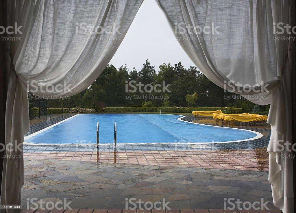 Swimming pool in the rain stock photo