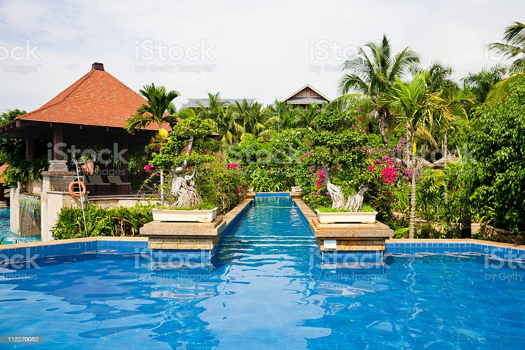 swimming pool in tropical garden royalty-free stock photo