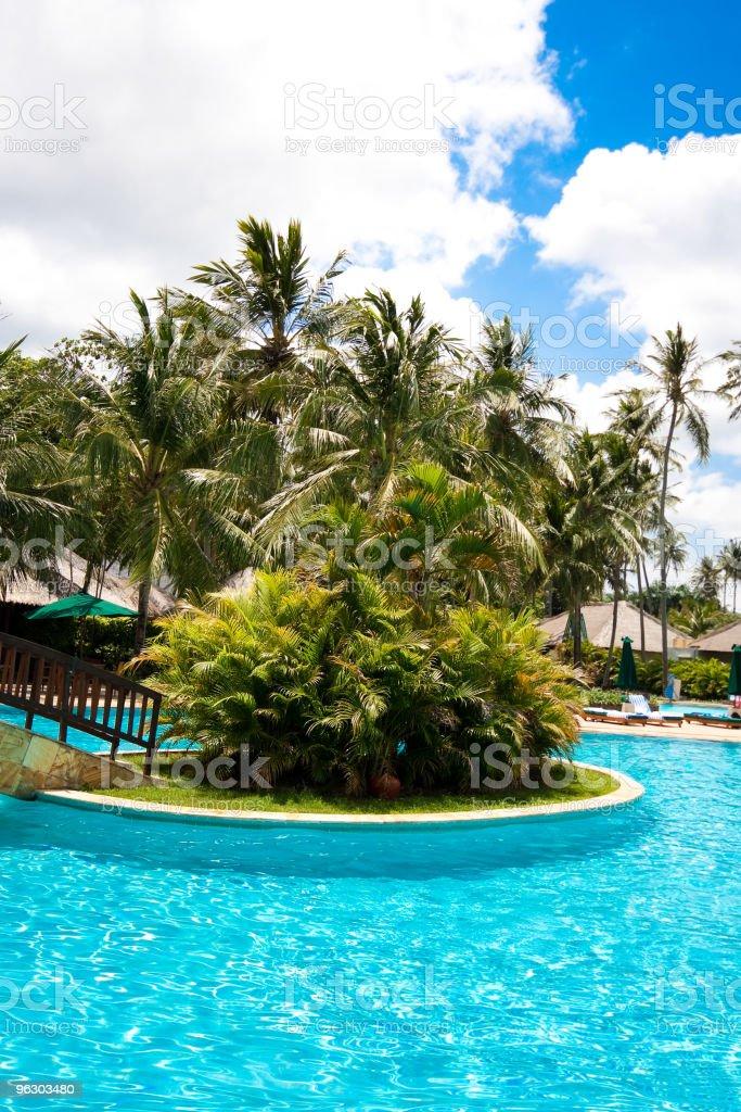 Swimming pool in tropical resort royalty-free stock photo