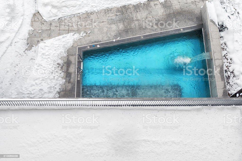 swimming pool in winter landscape stock photo