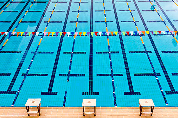 swimming pool lanes with line of colorful flags stock photo