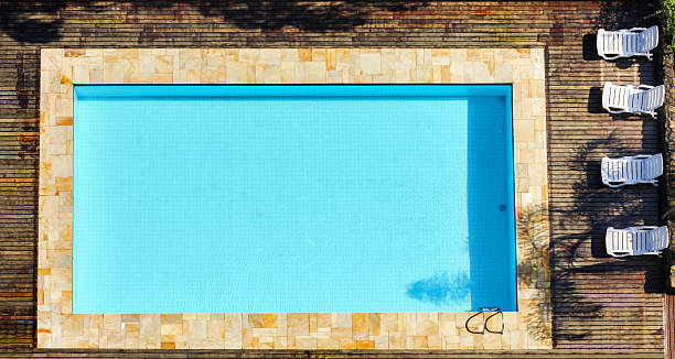 Overhead view of a swimming pool isolated on white stock photo rainier in the background an - Rectangle pool aerial view ...