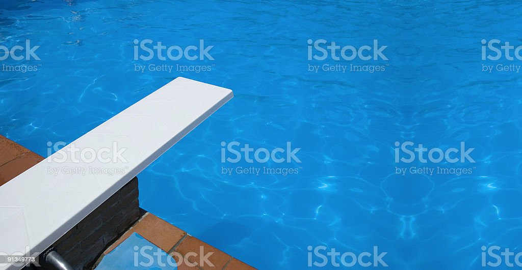 swimming pool springboard stock photo