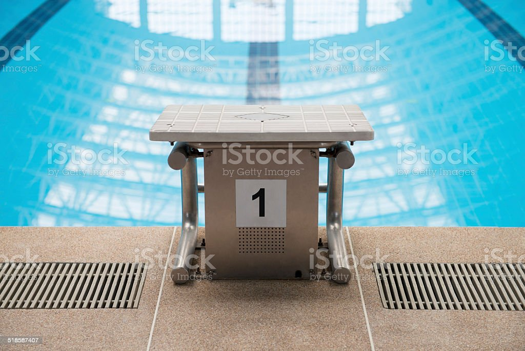Swimming pool starting block No.1 stock photo